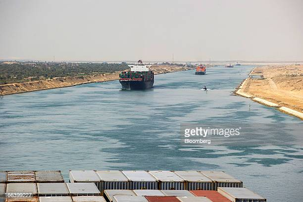 A convoy of container ships pass southbound along the Suez Canal in Egypt on Saturday April 6 2013 Maersk Line the world's biggest container shipping...