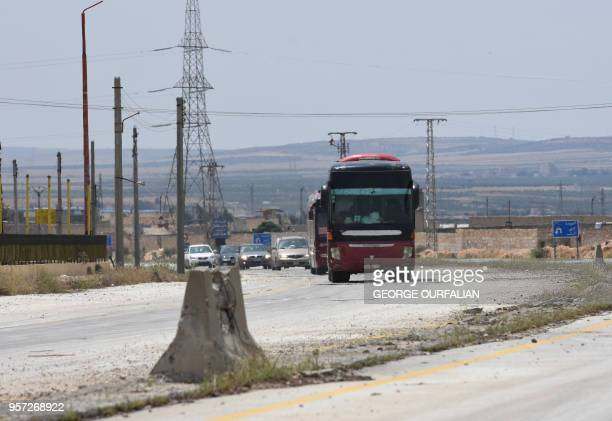 A convoy of evacuated opposition fighters from Yalda Beit Sahem and Bebla arrive at the entrance of Aleppo on their way to alBabJarablous crossing...