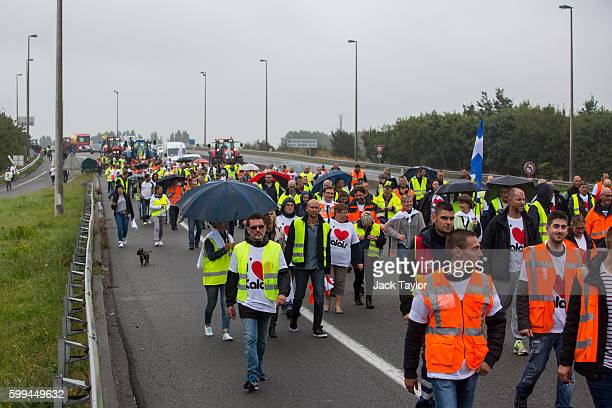 A convoy of farmers french business owners and locals blockade the main road into the Port of Calais as they protest against 'The Jungle' migrant...