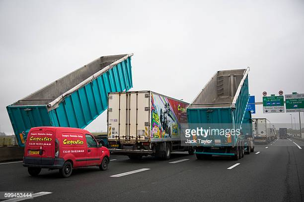 A convoy of farmers french businesses owners and locals blockade the main road into the Port of Calais as they protest against The Jungle migrant...