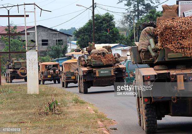 A convoy of French troops around fifty armored tanks and trucks arrives in Bangui on February 27 2014 from Chad to reinforce the French troops of...