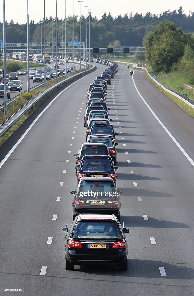 A convoy of hearses carry bodies and remains from those killed on Malaysian Airlines flight MH17 on July 24, 2014 in Boxtel, Netherlands. 70 more bodies have arrived today in Eindhoven. Malaysian Airlines flight MH17 was travelling from Amsterdam to Kuala Lumpur when it crashed in eastern Ukraine killing all 298 passengers. The aircraft was allegedly shot down by a missile and investigations continue to find the perpetrators of the attack.