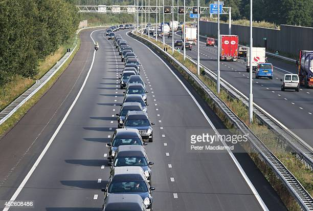 A convoy of hearses carry bodies and remains from those killed on Malaysian Airlines flight MH17 on July 24 2014 in Boxtel Netherlands 70 more bodies...