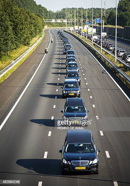 A convoy of hearses carrying coffins containing the remains of victims of the downed Malaysia Airlines flight MH17 drives near Boxtel from the...