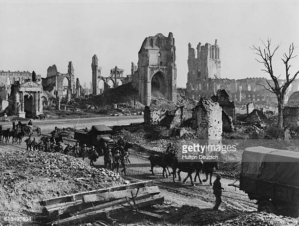 A convoy of horses and wagons pass by the ruins of St Martin's Church and the Cloth Hall of Ypres The city was almost totally destroyed in the long...