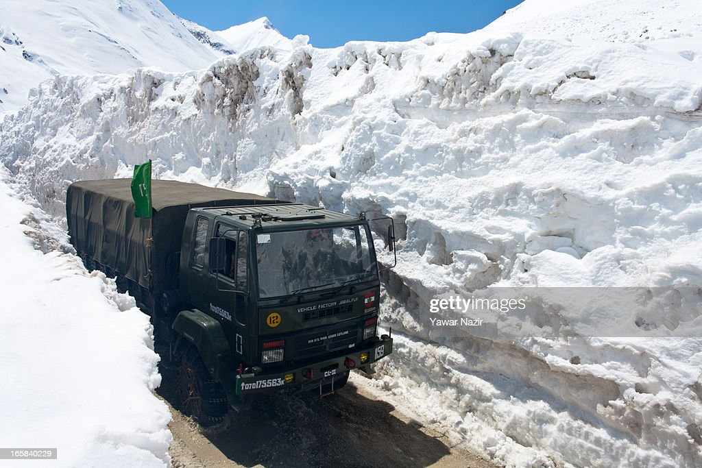 A convoy of Indian army passes through the snow-cleared Srinagar-Leh highway after it was reopen by authorities on April 06, 2013 in Zojila, 108 km (67 miles) east of Srinagar, the summer capital of Indian administered Kashmir, India. The 443 km (275 miles) long Srinagar-Leh highway was opened for vehicular traffic by Indian Border Roads Organisation after remaining snowbound at Zojila Pass for the past six months. The pass connects Kashmir with Ladakh region a famous tourist destination among foreign tourists for its monasteries, landscapes and mountains.