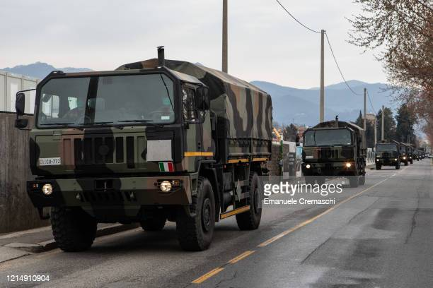 Convoy of military vehicles arrives at the Monumental Cemetery on March 26, 2020 in Bergamo, near Milan, Italy. The Italian Army has been brought in...
