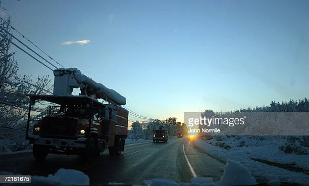 Convoy of NYSEG power trucks make their way to Buffalo October 13, 2006 in East Aurora, New York. A rare and record breaking early season snowfall...