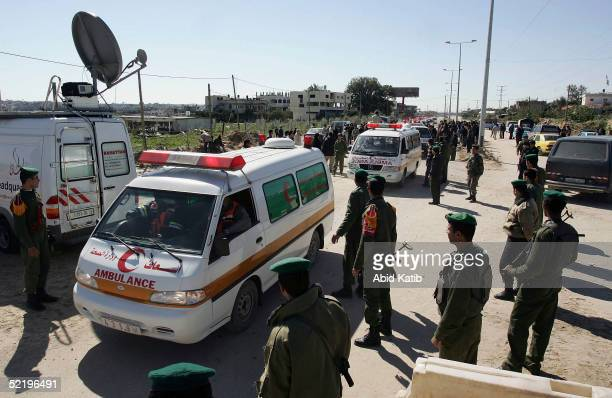 A convoy of Palestinian ambulances transports the bodies of 15 palestinian militants to Gaza City through the heavily fortified Erez Checkpoint on...
