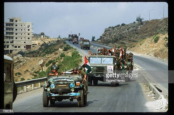 A convoy of Palestinian Libreration Army vehicles drive down a street August 8 1982 in Beirut Lebanon In 1982 a siege by Israeli forces led to the...