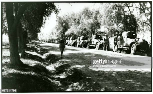 Convoy of Rolls Royce armoured vehicles line a tree-lined road believed to be near Srinagar. Background to this image: With the threat of War looming...