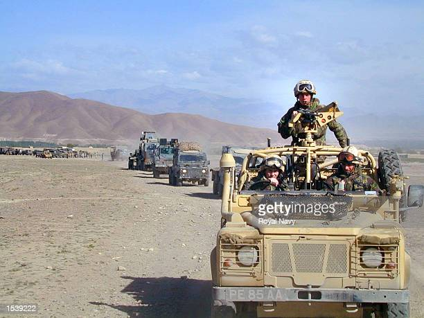 A convoy of Royal Marine Commandos makes its way through the Afghan countryside April 30 2002 on its way to the Forward Operating Base as the troops...
