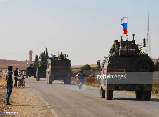 Convoy of Russian military vehicles drives toward the northeastern Syrian city of Kobane on October 23, 2019. - Russian forces in Syria headed for...