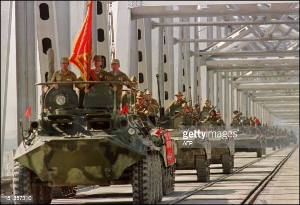A convoy of Soviet Army armoured personal vehicles cross a bridge in Termez 21 May 1988 at SovietAfghan border during the withdrawal of the Red Army...