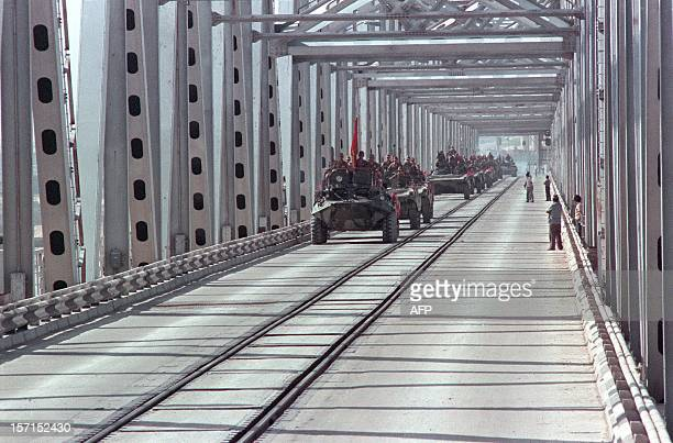 Convoy of Soviet Army armoured personnel vehicles cross a bridge in Termez at the Soviet-Afghan border, during the withdrawal of the Red Army from...