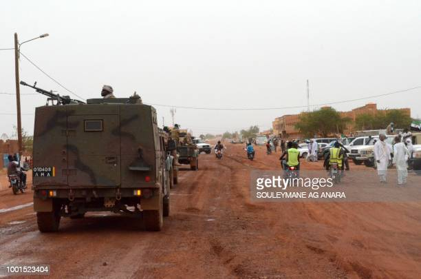 A convoy of the Malian army patrols the road leading to the airport in Gao on July 18 2018 as the incumbent Malian President Ibrahim Boubacar Keita...