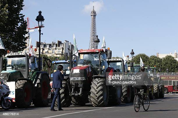 A convoy of tractors runs in a street of Paris on September 3 as farmers tried to clog up the capital's roads in protest at falling food prices The...