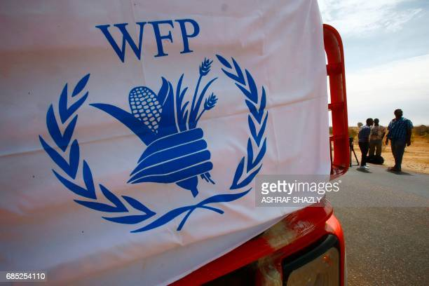 A convoy of trucks carrying humanitarian assistance provided by the World Food Program to Southern Sudanese refugees drives in the North Kordofan...