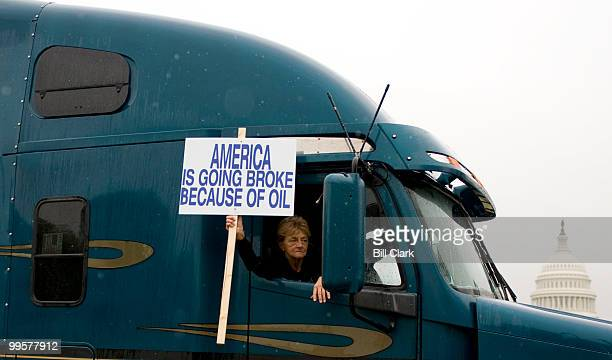 A convoy of trucks with their horns blaring drives down Third Street in fornt of the Capitol as they circle the National Mall to draw attention to...