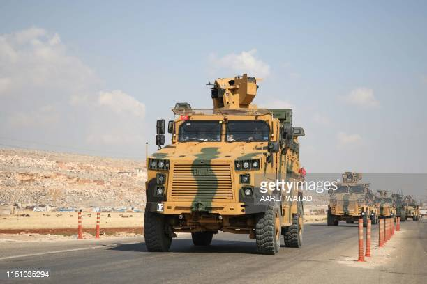 A convoy of Turkish armoured vehicles drive towards Bab alHawa crossing point between Syria and Turkey on a highway in the northern countryside of...