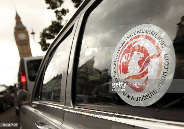 A convoy of Vauxhall cars drives around Parliament Square in Westminster in a protest to campaign to safeguard workers' jobs on July 15 2009 in...