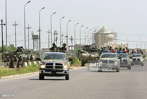 A convoy of vehicles carrying Iraqi policemen during a joint street patrol with US Army vehicles from the 1st Battalion 5th Infantry in the town of...