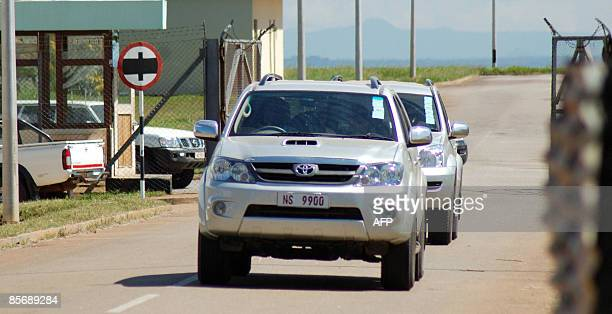 A convoy of vehicles carrying US pop supremo Madonna and her entourage exits the cargo section of Lilongwe's Kamuzu international airport on March 29...