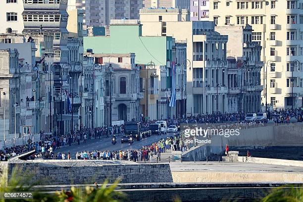 A convoy of vehicles escort the remains of former President of Cuba Fidel Castro along the malecon at the start of a journey across the country to...