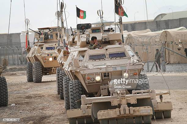 Convoy of vehicles from the Afghan National Army head out on patrol with the U.S. Army's 4th squadron 2d Cavalry Regiment on March 2, 2014 near...