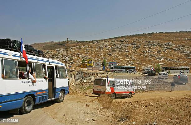 A convoy secured by the French Commando Hubert departs from the southern town of Nabatiyeh to Beirut 23 July 2006 Some 100 Lebanese families of...