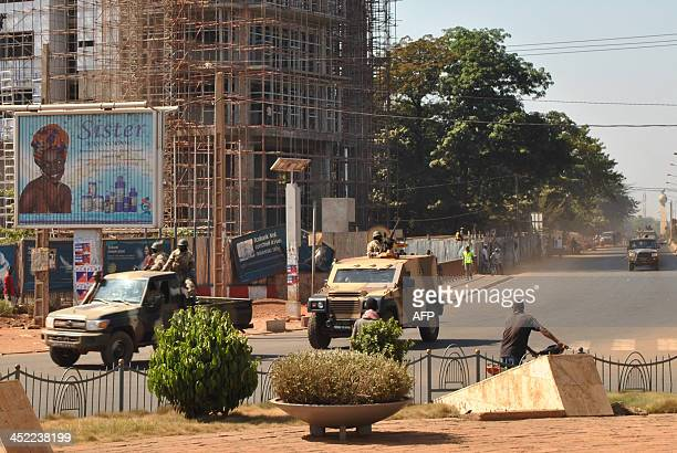 A convoy transporting Malian excoup leader Amadou Sanogo drives to the gendarmerie in Bamako on November 27 2013 Sanogo who led a March 2012 coup in...
