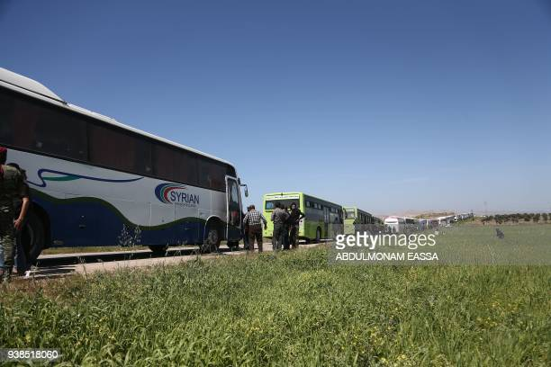 TOPSHOT A convoy transporting Syrian civilians and rebel fighters evacuated from Eastern Ghouta waits in a governmentheld area prior to entering the...