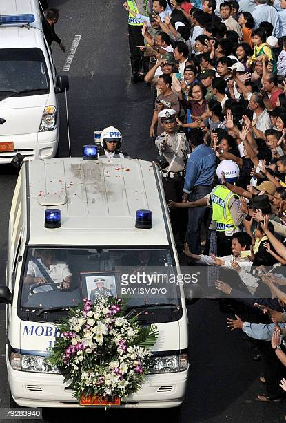 A convoy transporting the coffin carrying the body of Indonesia's former president Suharto is driven through the streets of Jakarta ahead of a state...