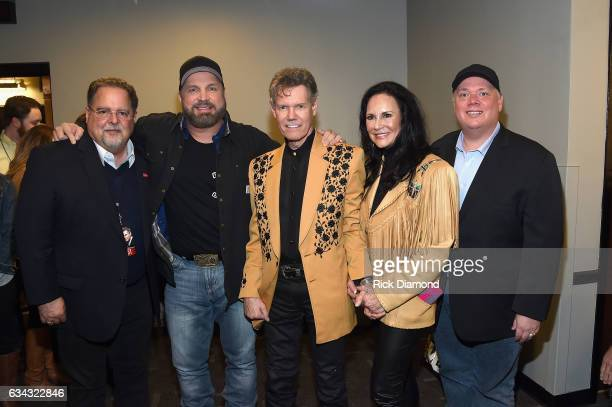 Conway Entertainment Group's Tony Conway Garth Brooks Randy Travis Mary Travis and Webster PR's Kirt Webster pose backstage during 1 Night 1 Place 1...