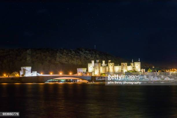 Conwy Castle and bridge reflected in the River Conwy at night, North Wales, UK