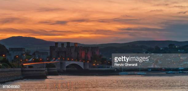 conwy castle and townscape in background at sunset, conwy, wales, uk - renzo gherardi stock photos and pictures