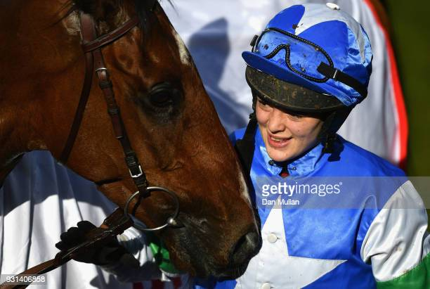 Coo Star Sivola ridden by Lizzie Kelly celebrates victory during the Ultima Business Solutions Handicap Chase on Champion Day of the Cheltenham...