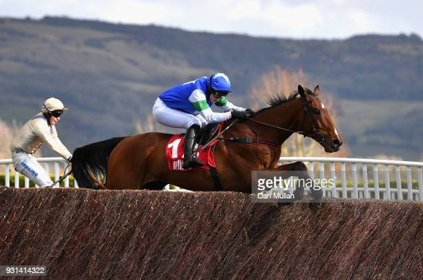 Coo Star Sivola ridden by Lizzie Kelly clears the second last during the Ultima Business Solutions Handicap Chase on Champion Day of the Cheltenham...