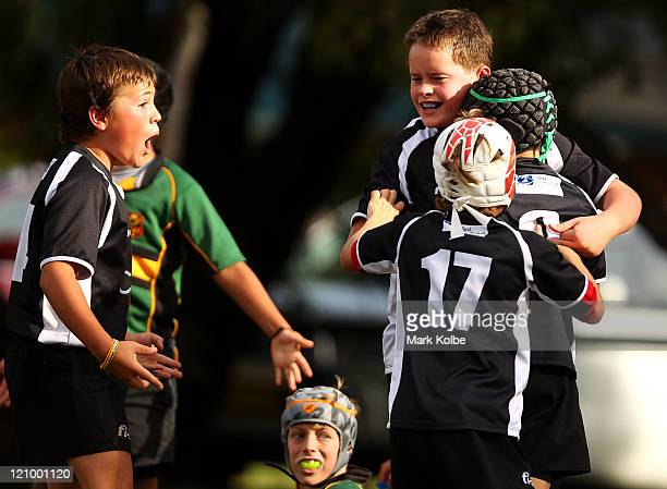 Coogee Grey players celebrate after a try during the under 10's junior rugby union semi final match between Oatley and Coogee Grey at Nagle Park on...