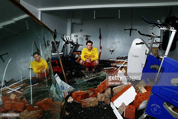 Coogee SLSC volunteer Benjamin Heenan poses amongst the damaged Coogee SLSC on June 7 2016 in Sydney Australia A huge wave hit the eastern wall of...