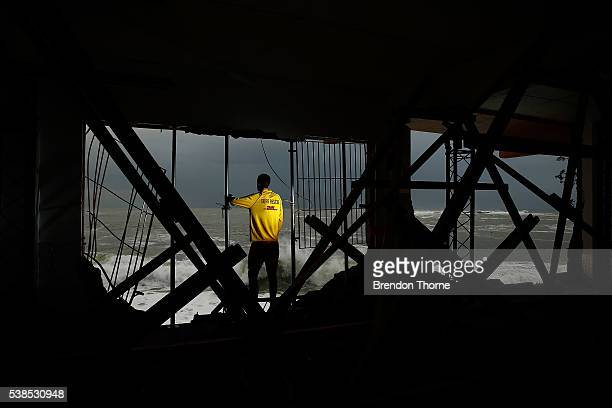Coogee SLSC volunteer Julien Vincent poses amongst the damaged Coogee SLSC on June 7 2016 in Sydney Australia A huge wave hit the eastern wall of the...