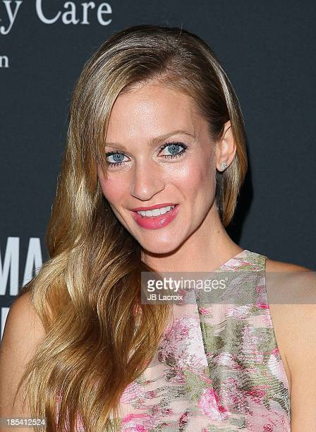 J Cook attends Elyse Walker Presents The Pink Party 2013 hosted by Anne Hathaway at The Barker Hanger on October 19 2013 in Santa Monica California