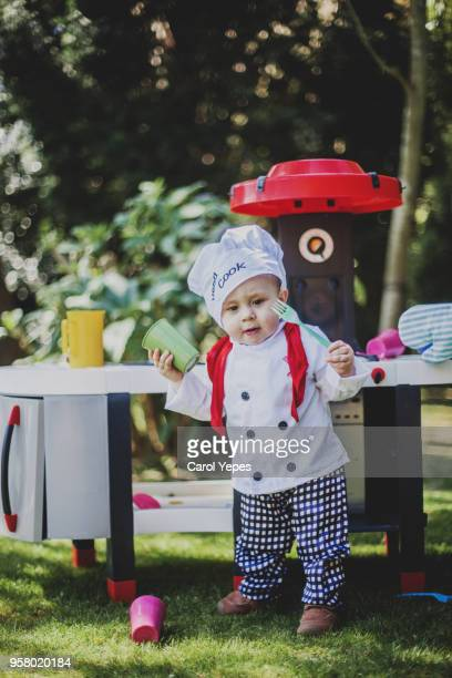 cook boy outdoors - carol cook stock pictures, royalty-free photos & images