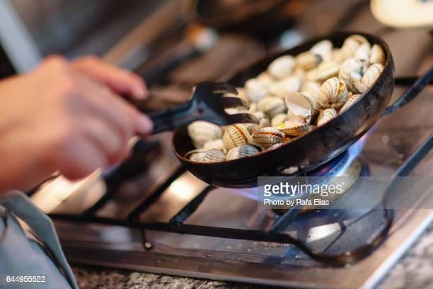 Cook cooking cockles