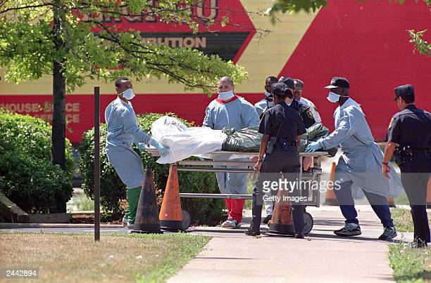 A Cook County medical examiner pushes a gurney 16 July carrying the body of one of 116 people killed by heat related causes in Chicago after record...