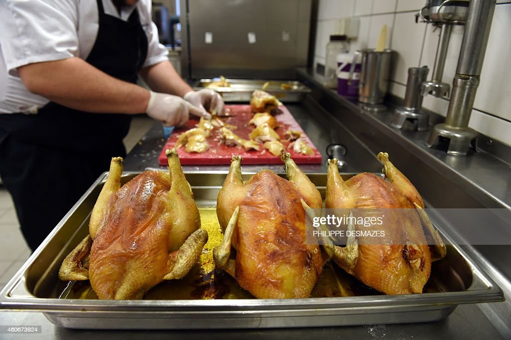 A Cook Cuts A Poulet De Bresse Chicken During A Tasting Contest Of