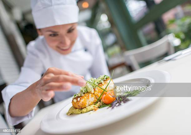 cook decorating a beautiful plate - seafood stock pictures, royalty-free photos & images