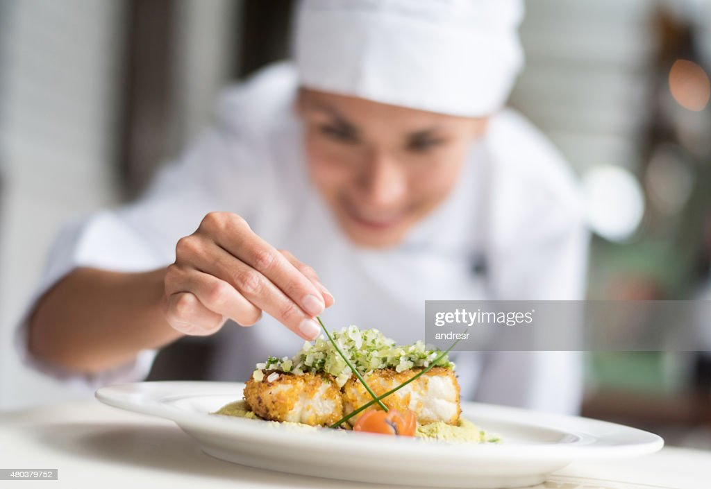 Cook decorating a plate : Stock Photo