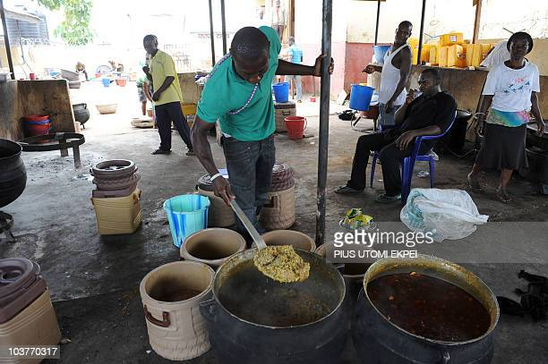 A cook examines the soup prepared for the arrival of 1000 exmilitants at the Amnesty Camp at Obubra in Cross River State on September 1 2010 One...