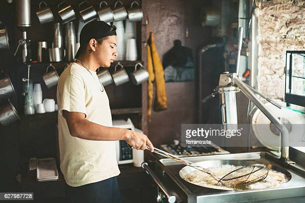 cook frying mexican churros - churro stock photos and pictures